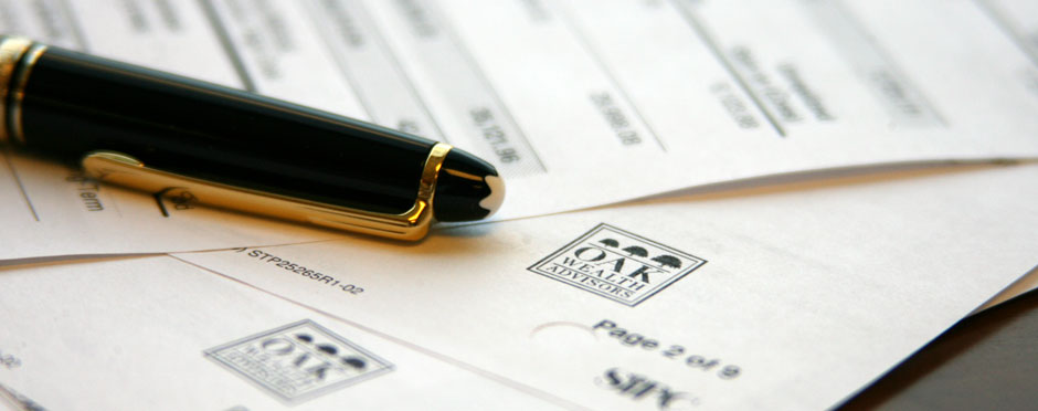 pen and documents about wealth management